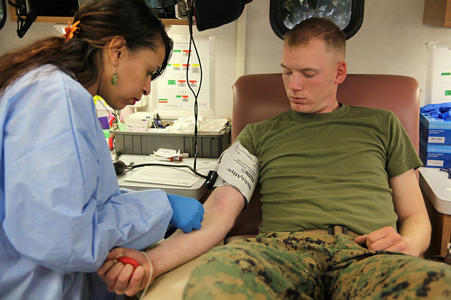 phlebotomist extracting blood