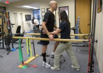physical therapy assistant and patient