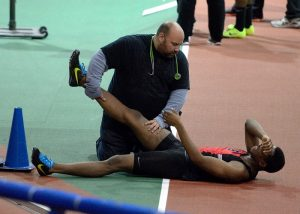 athletic trainer helping an athlete