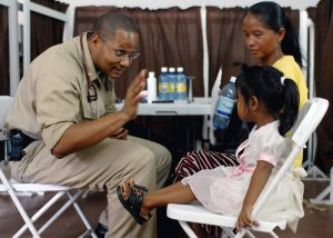 a family physician examining a child