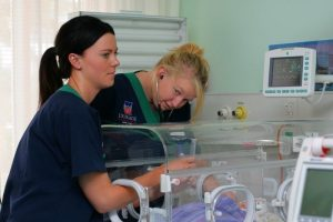 neonatal nurses caring for an infant