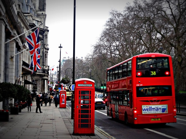 UK downtown with red bus and red telephone booth