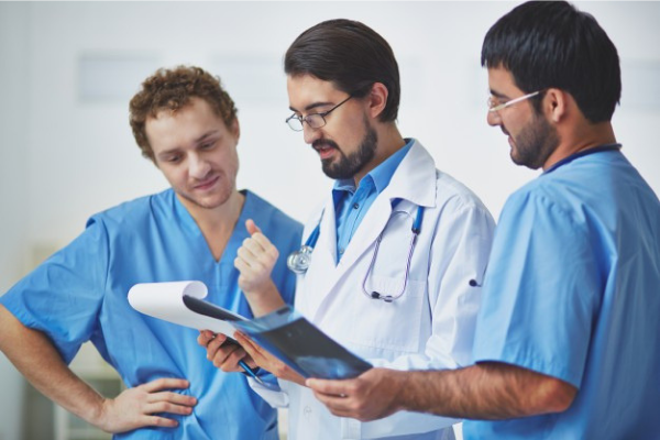 doctors looking at patient file