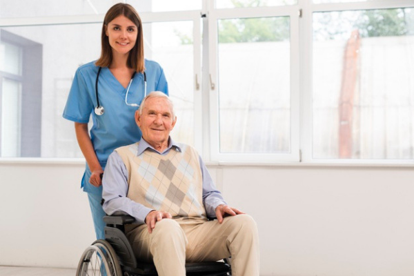 nurse and old man patient in wheelchair